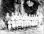 Baseball team players posed on railroad tracks, Snohomish County, ca. 1913