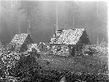 Log cabin and shed with shake roof, Snohomish County, ca. 1911