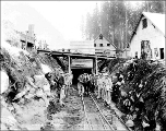 Great Northern Railway construction crew and horse at the west portal of the Cascade Tunnel,...