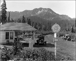 Automobile at gas station, summit of Stevens Pass, 1926