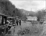 Automobiles and trucks at scene of highway washout near Index, ca. 1926