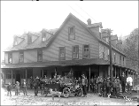 Group of people posed with automobile in front of the Index Hotel, Index, October 12, 1911