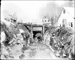 Men and horse pulling tram car at tunnel entrance, Scenic, ca. 1926