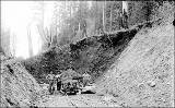 Work crew with muck car on tracks, Snohomish County,  ca. 1910