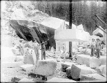Index Granite Works showing men hoisting large block, Index, ca. 1911