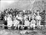 Baseball team and spectators on bleachers, Skykomish, ca. 1911