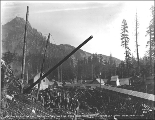 Raising a power line pole at Scenic, ca. 1926