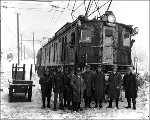 Inspecting new Great Northern railroad cars during snow storm, 1927