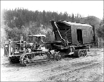 Caterpillar hauling a steam shovel, ca. 1927