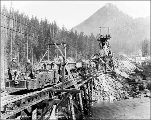 Muck train and workers at the west portal, Scenic, ca. 1927