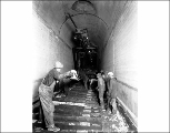 Laying rails in the Winton Tunnel, ca. 1928