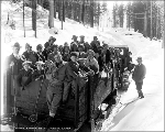 Tractor and sled hauling group through the snow, Mill Creek, ca. 1928