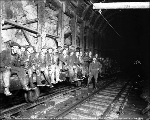 Man train at cross cut 10 in the main bore, Cascade Tunnel, ca. 1928