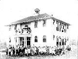 Children posed in front of school, Gold bar, 1911