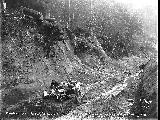 Automobile and men on muddy road, Snohomish County, 1911
