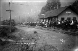 Crowd of people at the Great Northern Railway station, Index, ca. 1913