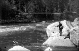 Man with fishing pole, near Settler's Bridge on the Skykomish River, ca. 1916