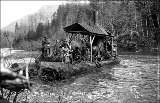 Donkey engine and logging crew tethered on the banks of the Skykomish River, n.d.