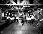 Bunk house interior showing work crew at Mill Creek, July 1, 1928