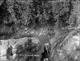 Man standing at Hells Gate, Eagle Falls, n.d.