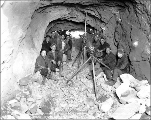 Engineers at the breakthrough between the east portal tunnel and Mill Creek shaft, 1927