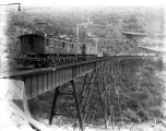 Electric engine pulling freight train on the Martin Creek Bridge, ca. 1928