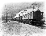 Great Northern Railway electric engines pulling passenger train out of snowsheds, Tye, August 2,...