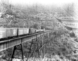 Freight train on the Martin Creek Bridge at the west portal of the Horseshoe Tunnel, ca. 1928