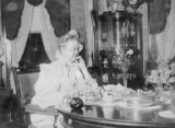 Lucy Virginia Semple Ames at breakfast in the dining room at Notchcliff