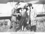 Bertha K. Landes with Mr. Tyler and Mr. Spangler in front of an early airplane, 1926