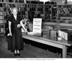 Madeline Gilchrist, librarian, beside a display of early Spenser editions which were donated to...