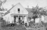 Charles Newton and Elizabeth Jane Byles with woman on porch of their house with children Annie,...