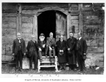 Ezra Meeker, George H. Himes, and Rolf Granger with other dignitaries at the granary at Fort...