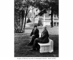 Edmond and Lizzie (Ward) Meany seated on bench, University of Washington campus, n.d.