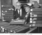 Harry C. Bauer and Lulu Fairbanks examining the Eric A. Hegg photograph albums, n.d.