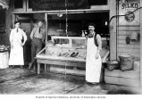 Salti Levy (left) and Solomon Calvo (right) in front of the Western Fish and Oyster Co., Pike...