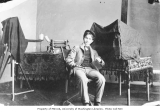 Clark Kinsey in studio with photographic equipment, ca. 1899