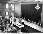 Joseph Drumheller cutting a cake at the Golden Jubilee Luncheon, Spokane, Washington, 1948