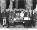 Governor Daniel J. Evans signing House Bill 74 before assembled dignitaries, ca. 1972