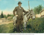 John L. Miller with donkey, Seattle, ca. 1911-1919