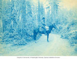 Charles Landes on a horse, Washington, early 1900s
