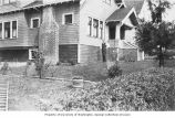 Andrew Winberg standing in front of Winberg home, Aberdeen, Washington, ca. 1910