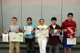 Contest winners holding their entries at the Bilingual Awards assembly, Forks Elementary School,...
