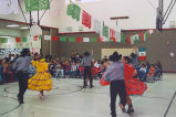 Dancing group from Yakima performing at Forks Elementary School gymnasium, Forks, ca. 1995