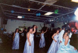 Quinceañera celebration showing courtiers dancing, probably on the Olympic Peninsula, ca. 2002