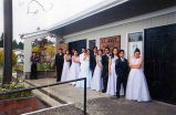 Quinceañera of Lizbeth shown outside St. Ann's Catholic Church with her chambelanes and damas,...