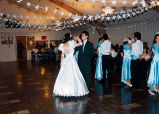 Quinceañera of Cecilia shown dancing with a chambelán, probably on the Olympic Peninsula, 1995