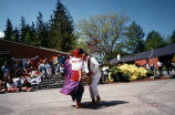 Latino man and woman presenting a traditional dance outside Peninsula College Bookstore, Port...