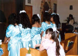 Quinceañera damas inside the St. Anne's Church during the mass, Forks, ca. 2002