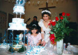 Quinceañera of Cecilia with her sister Rubi cutting cake, Olympic Peninsula, 1995